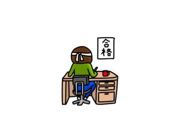 学習机で試験の勉強をしている男性。